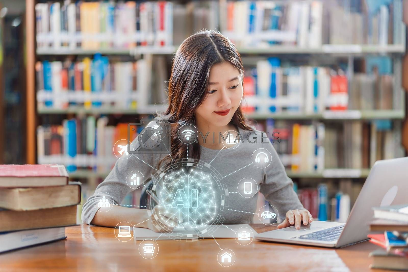 Polygonal brain shape of an artificial intelligence with various icon of smart city Internet of Things Technology over Asian young Student using technology laptop in library of university