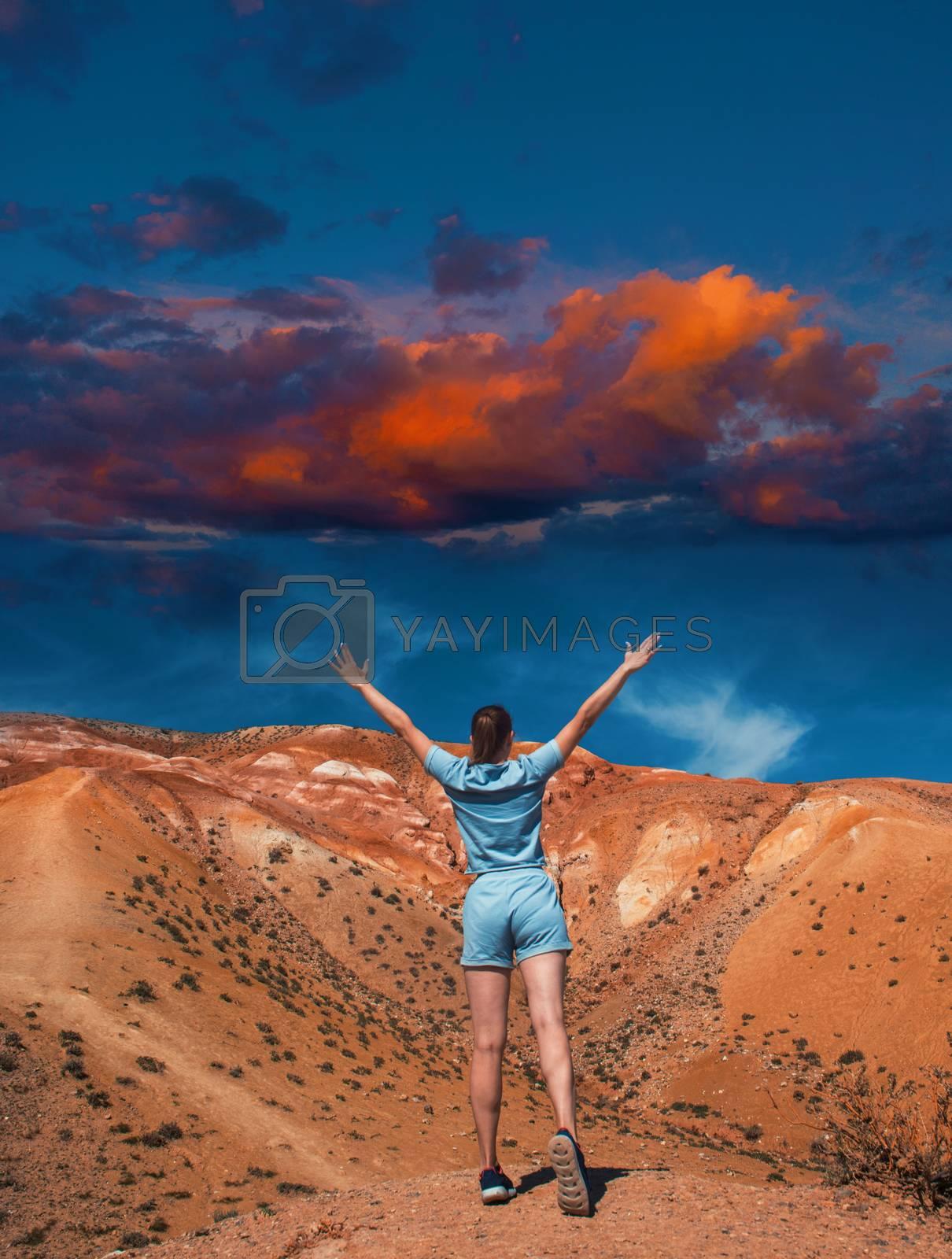 Woman on mars landscape with beauty sky sunset