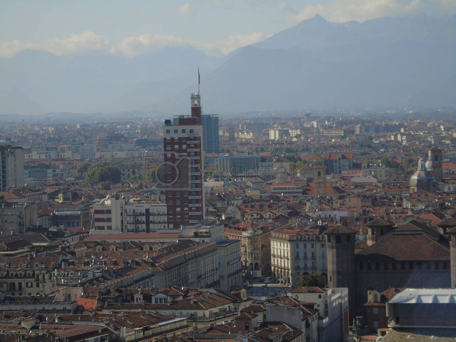 Turin, Italy - 06/06/2020: Beautiful panoramic view from Mole Antoneliana to the city of Turin in summer days with clear blue sky and the alps in the background.