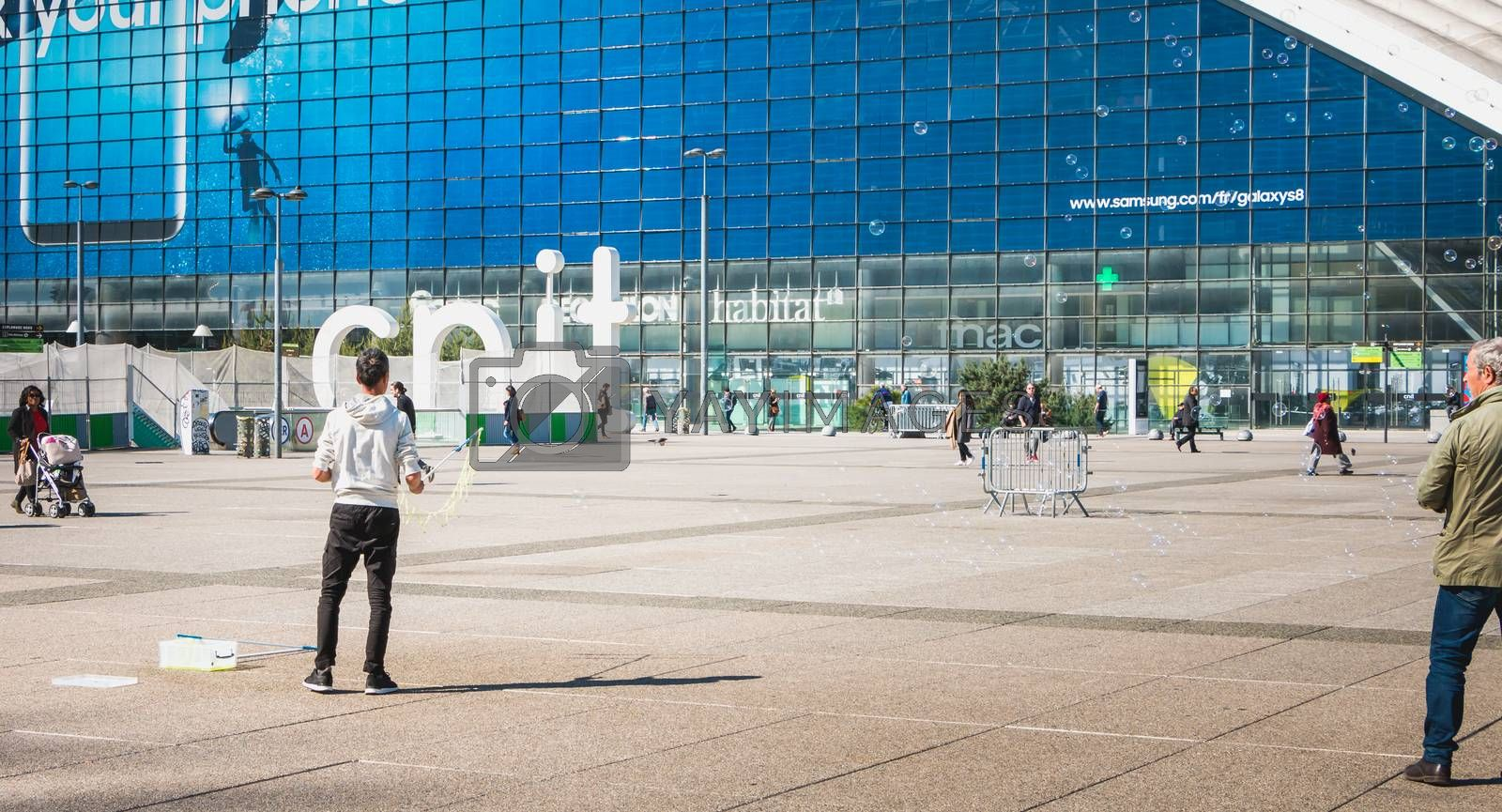 man makes giant bubbles in the middle of a central square by AtlanticEUROSTOXX