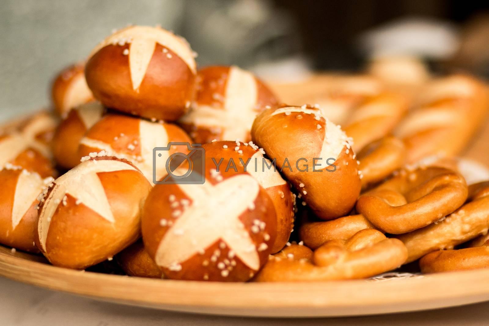 bun roll pretzel salty food bakery basket german breakfast . High quality photo