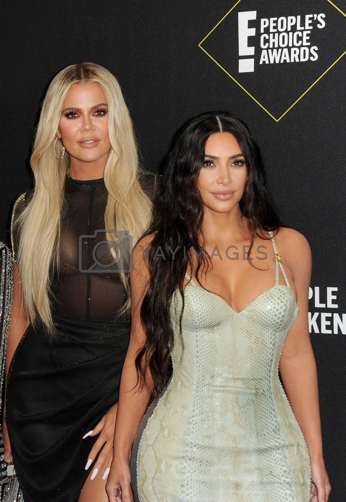 Royalty free image of Kim Kardashian and Khloe Kardashian by Lumeimages