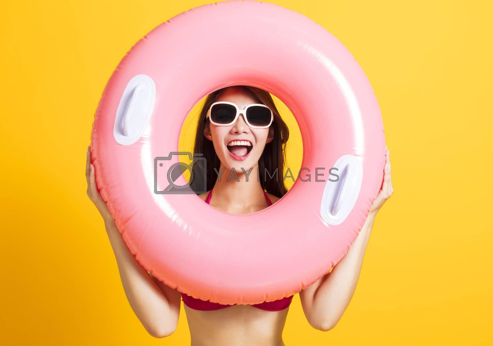 excited Young beautiful woman wearing swimsuit bikini