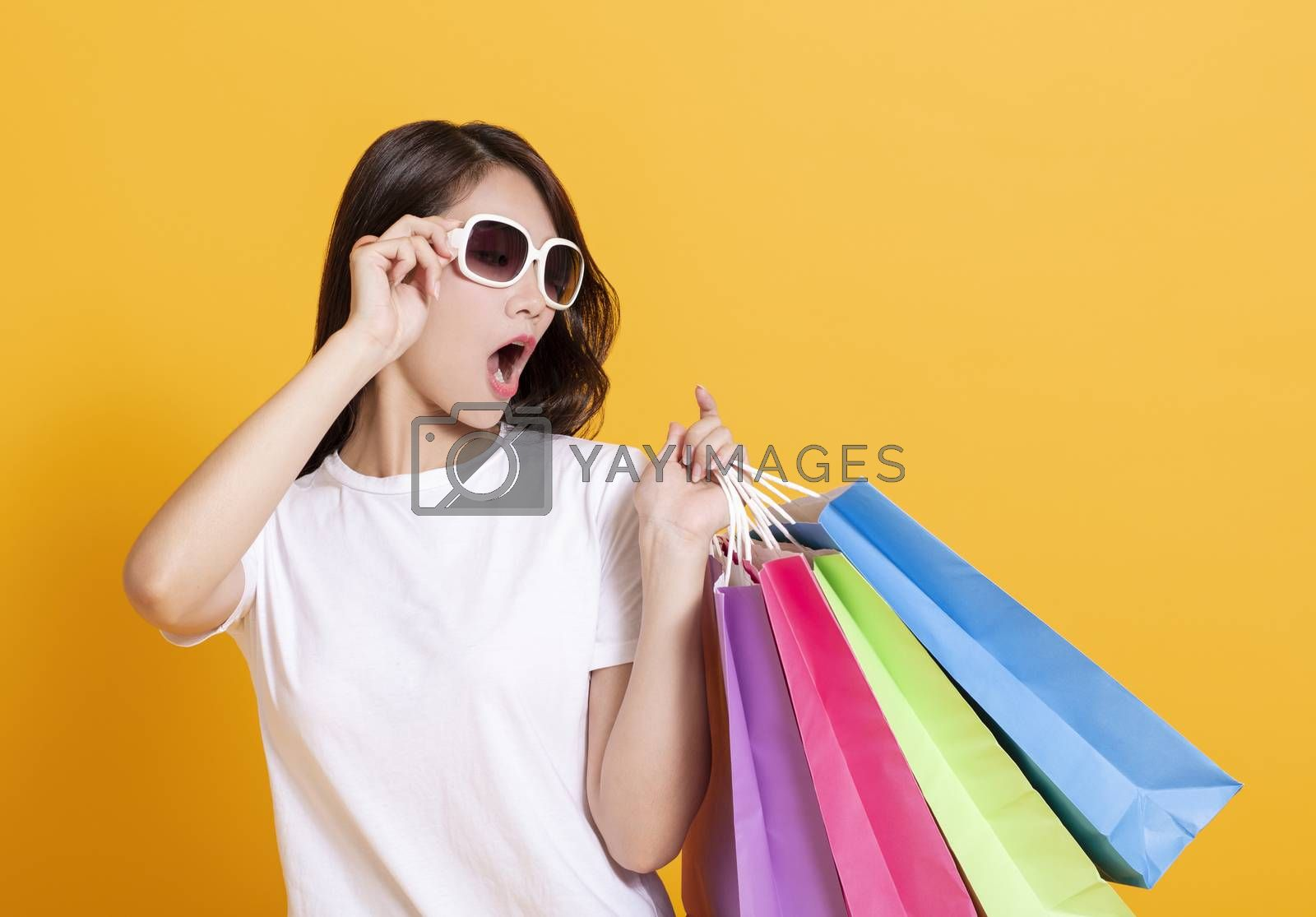 surprised young woman watching the shopping bags