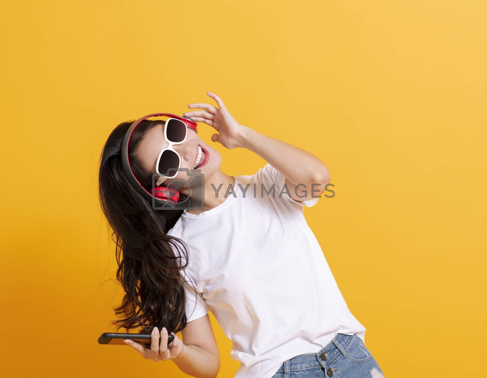 happy woman listening to music and dancing with headphone