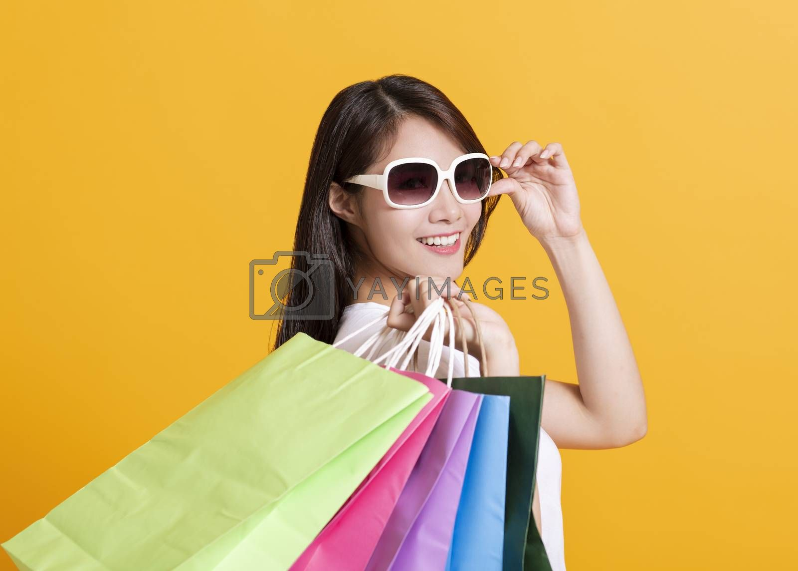 happy young woman holding the shopping bags