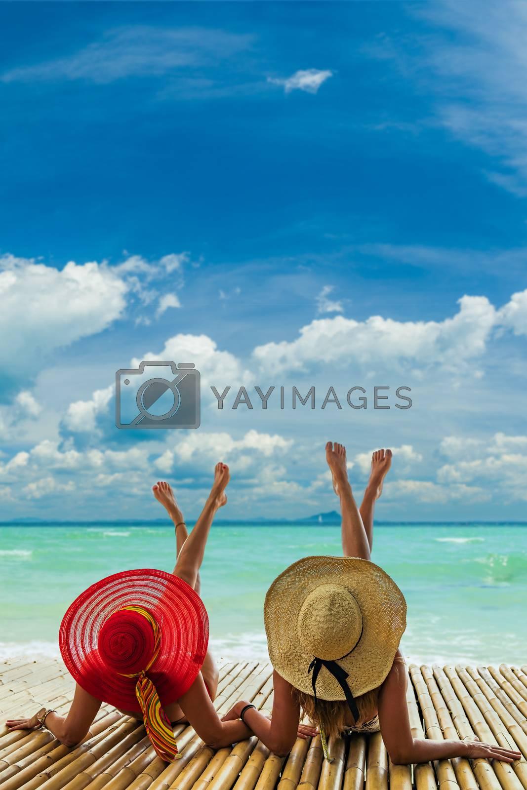 Two beautiful women enjoying the tropical beach in Thailand