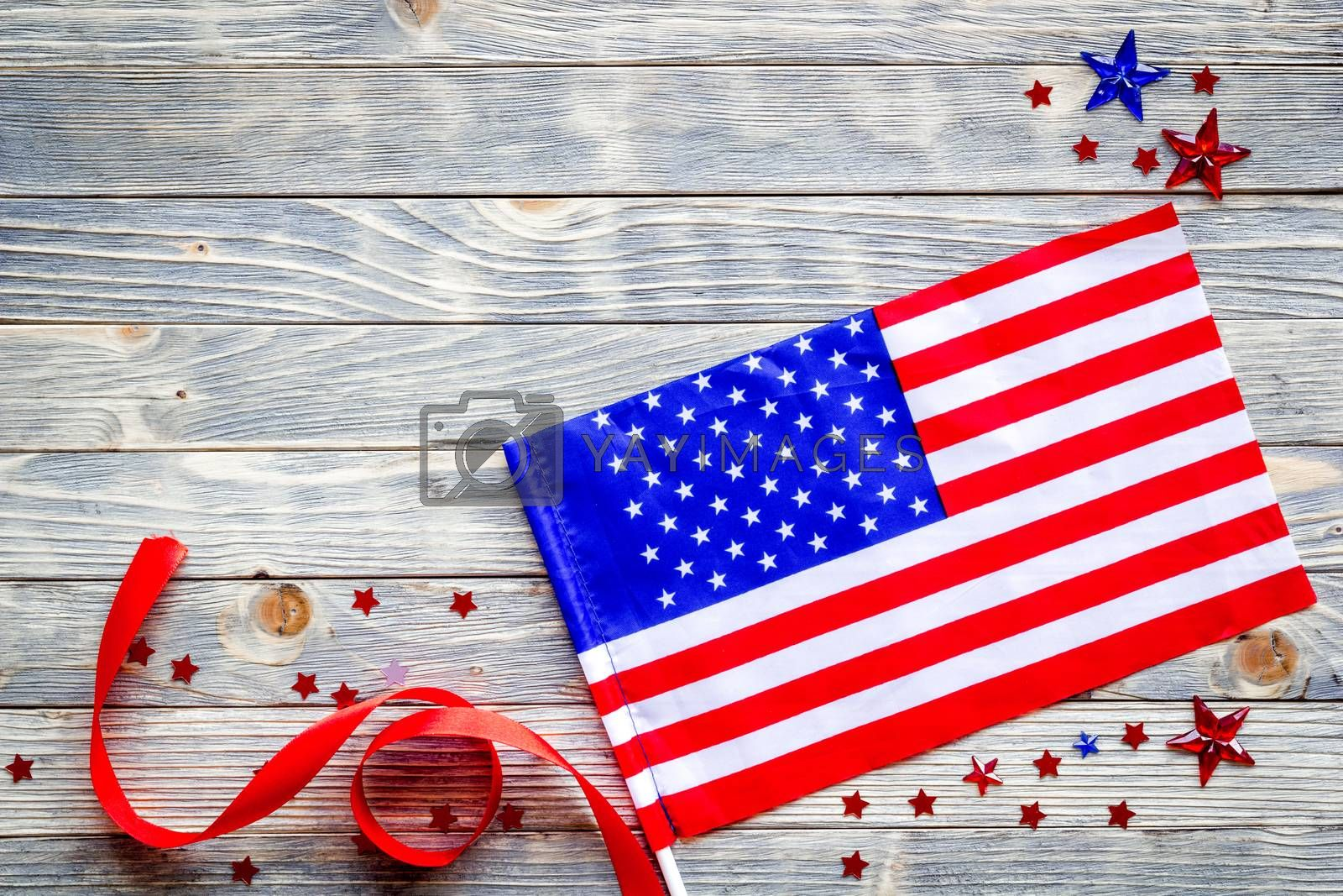 Royalty free image of 4th July celebration. American flag on wooden backrgound top view copy space by 9dreamstudio