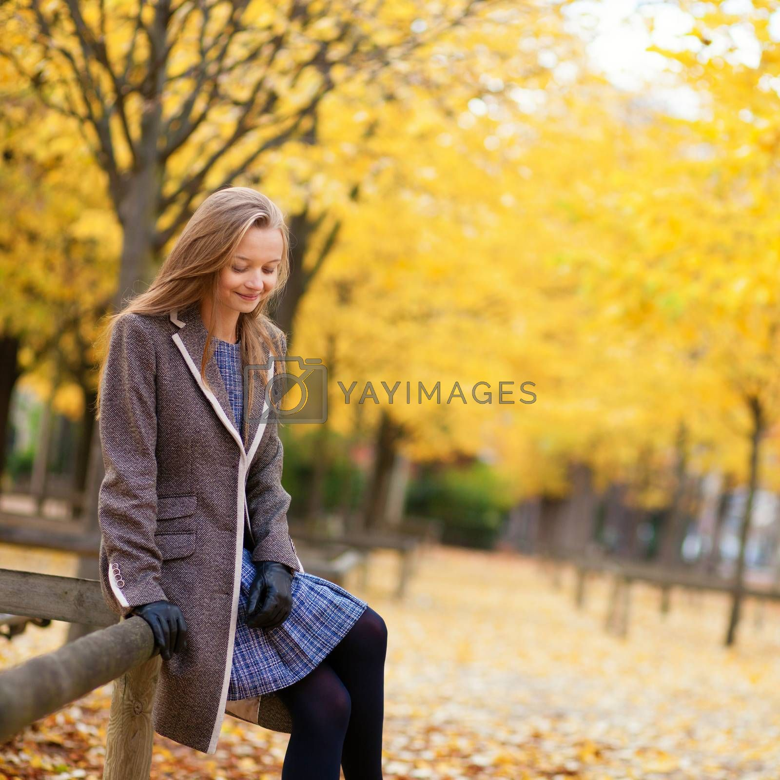 Girl enjoying beautiful fall day