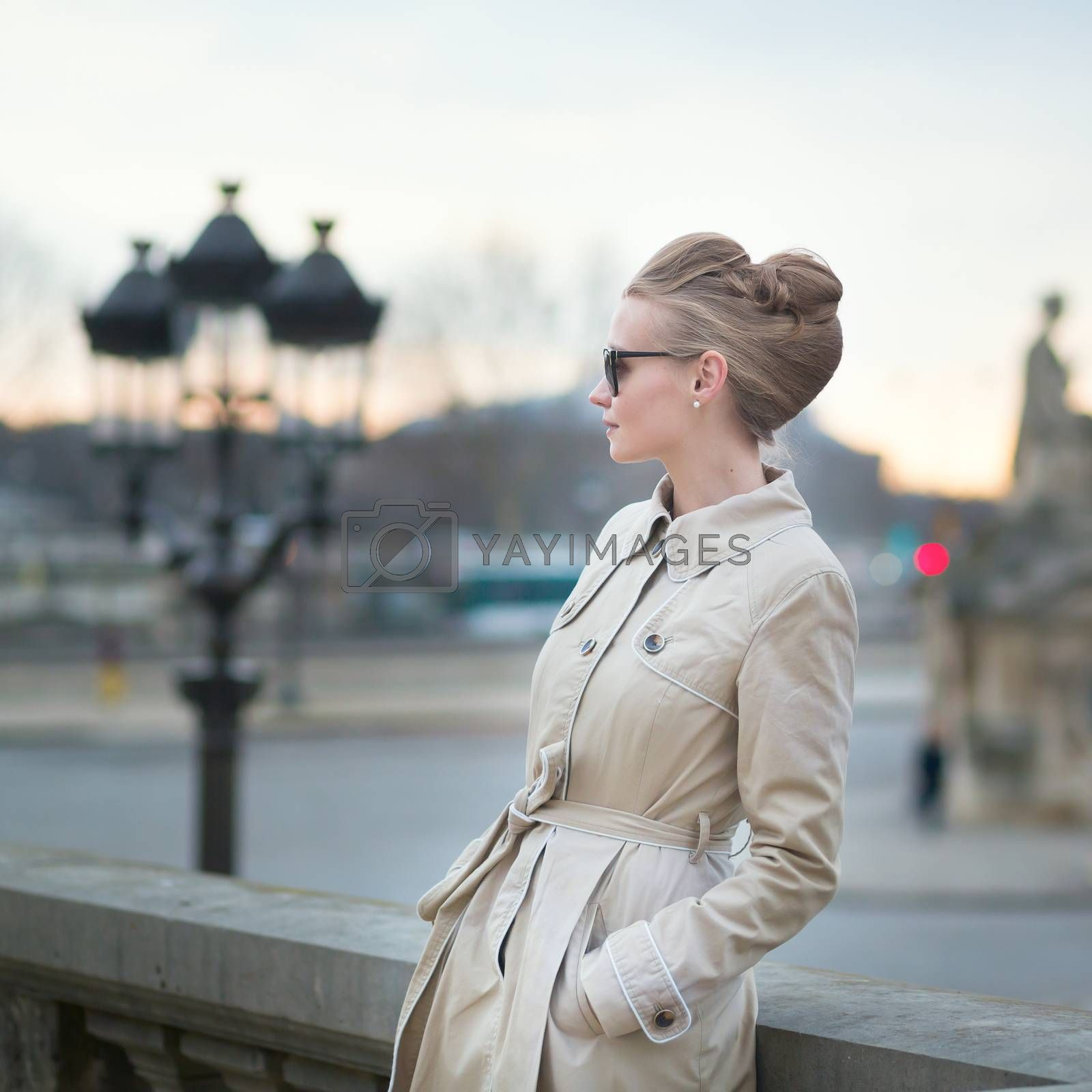 Elegant young Parisian woman outdoors