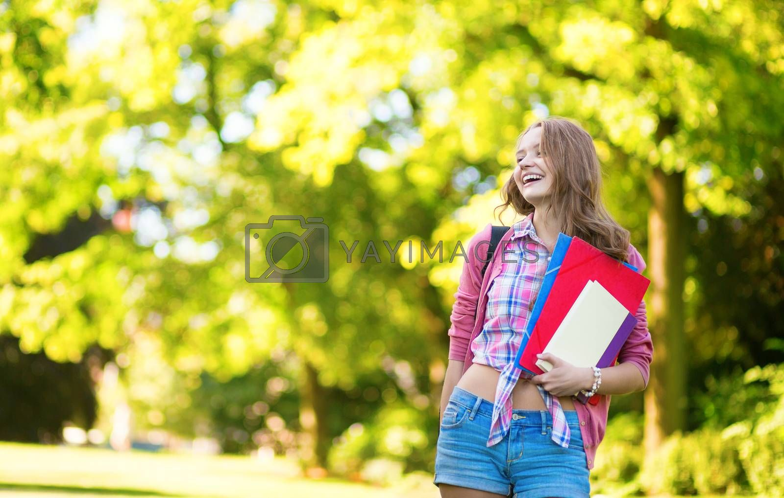 College student with books and folders by jaspe