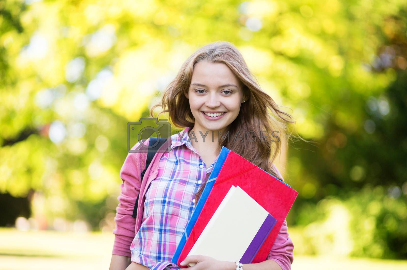 Student girl going back to school and smiling by jaspe