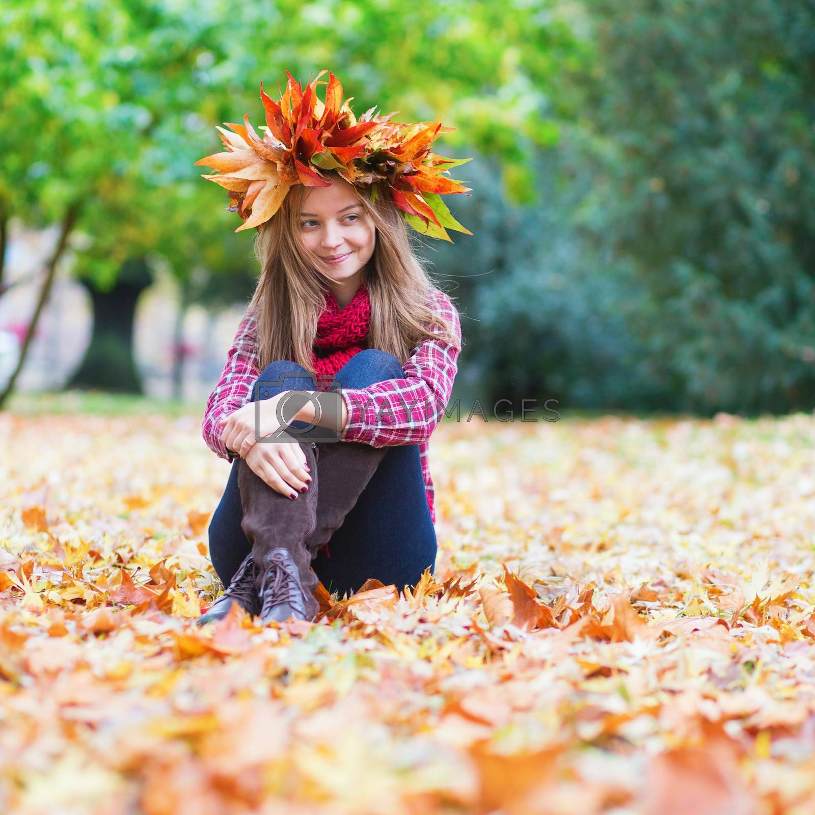 Happy young girl in park on a fall day