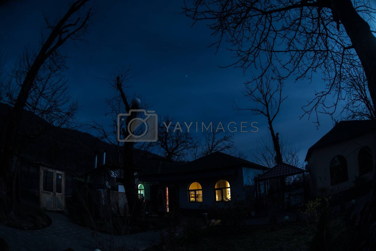 Full moon over quiet village at night. Beautiful night landscape of mountain village under the moonlight. Azerbaijan nature. Long exposure shot