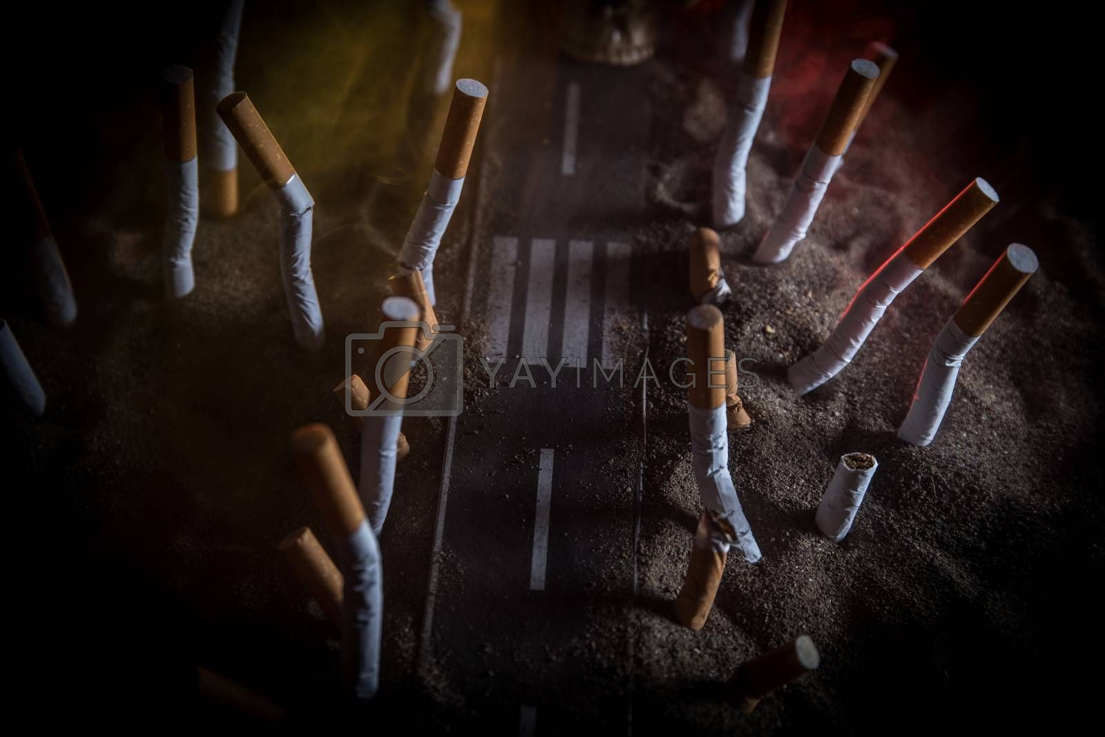 No smoking concept. Creative artwork table decoration with cigarettes. Cigarettes cause cancer and kill. Road to the death. Death row with cigarettes. Selective focus