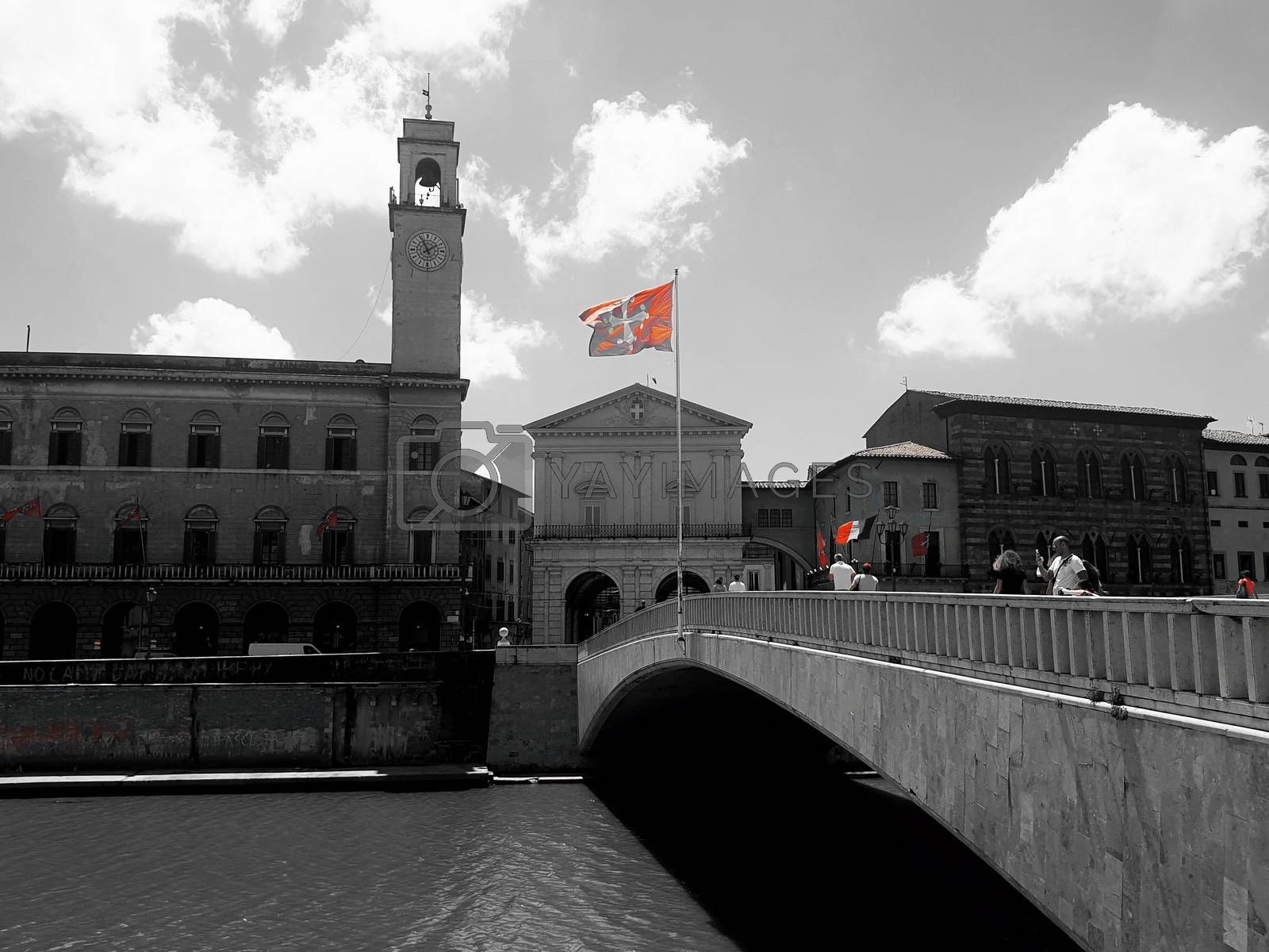 The red flag of Pisa in red on a black and white picture of the brdige called Ponte di Mezzo