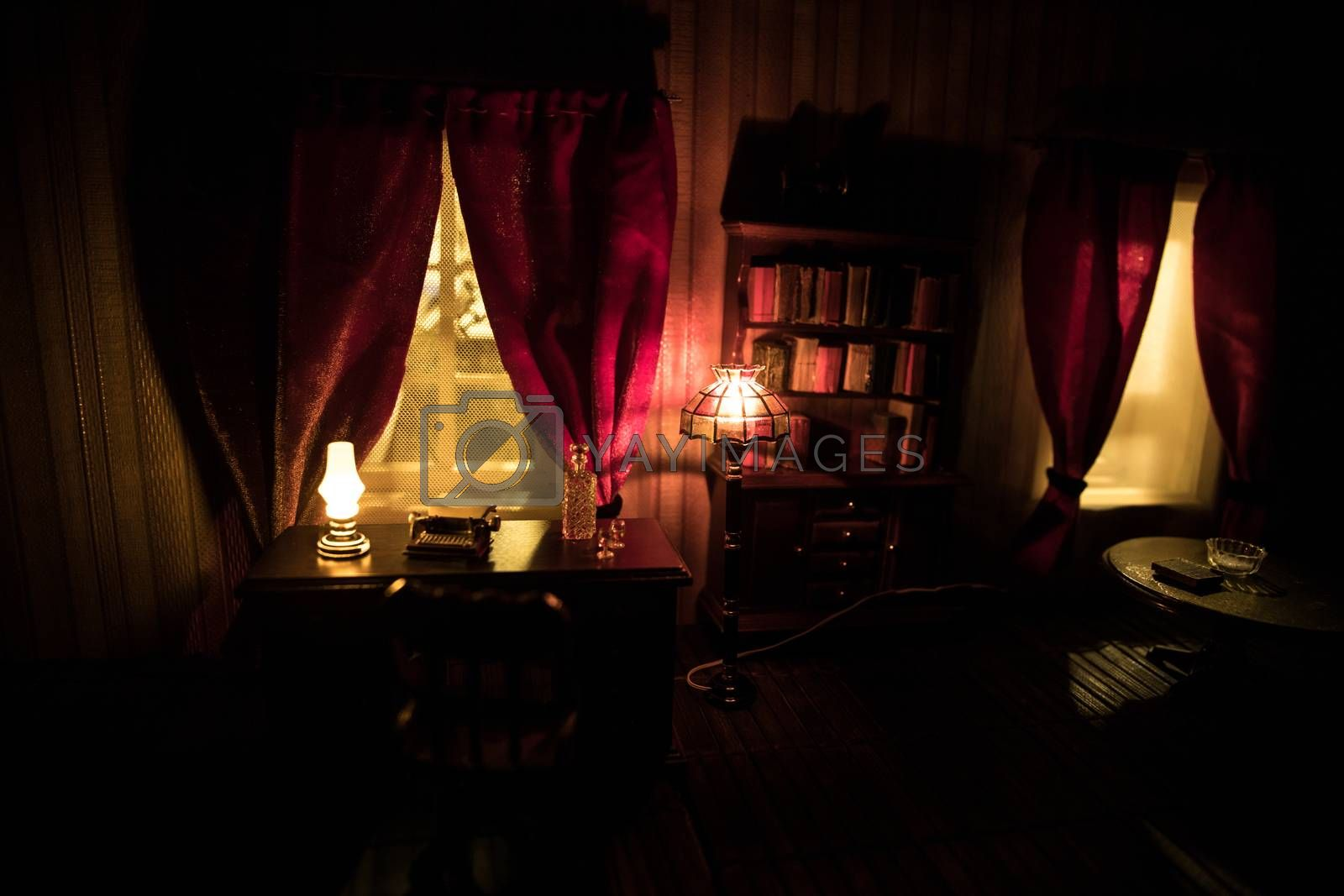 A realistic dollhouse living room with furniture and window at night. Artwork table decoration with handmade realistic dollhouse. Selective focus.