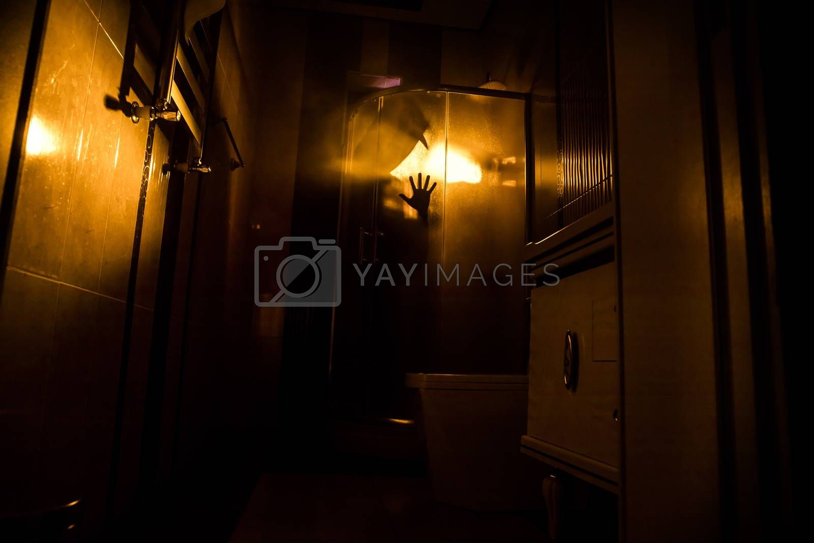 Halloween concept. Horror silhouette of person in shower cabin. Killer maniac inside bathroom with glowing lights. Long exposure