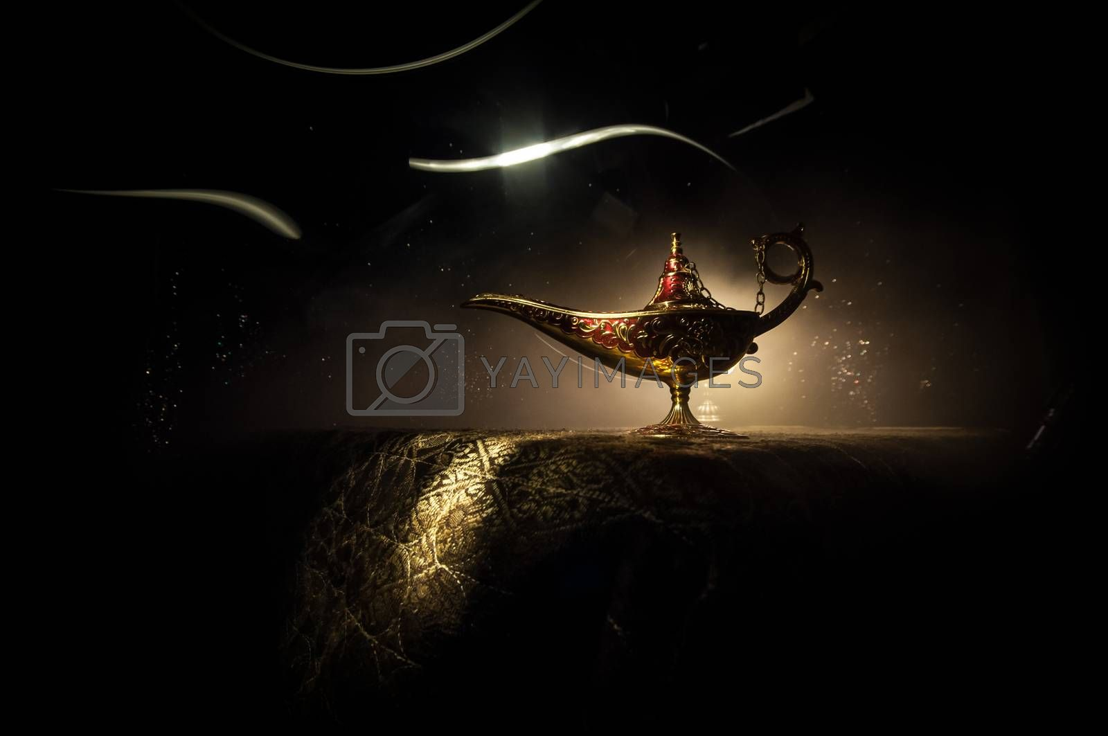 Antique Aladdin arabian nights genie style oil lamp with soft light white smoke, Dark background. Lamp of wishes concept