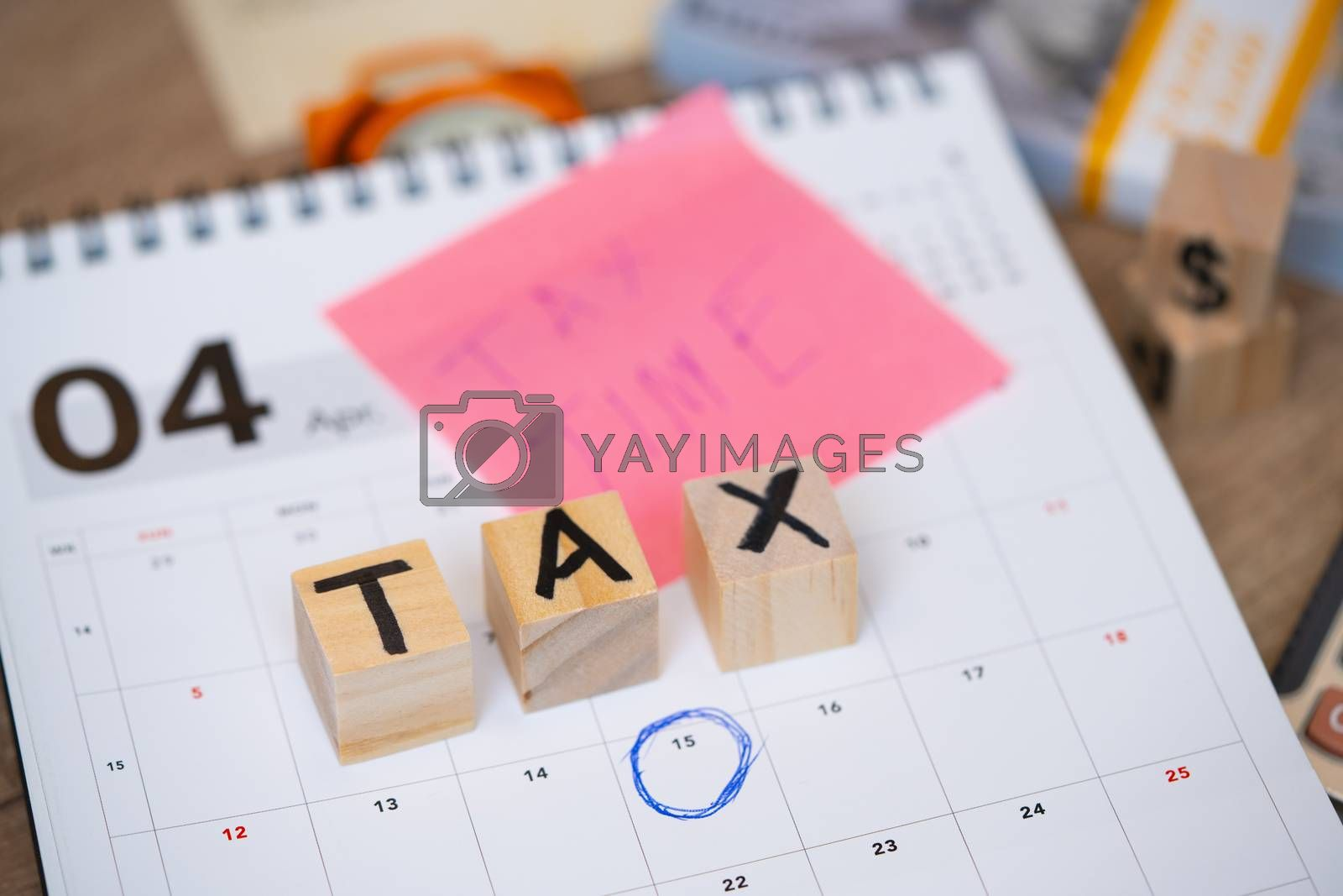 "Word ""Tax"" with clock on the office workplace. Business concept"