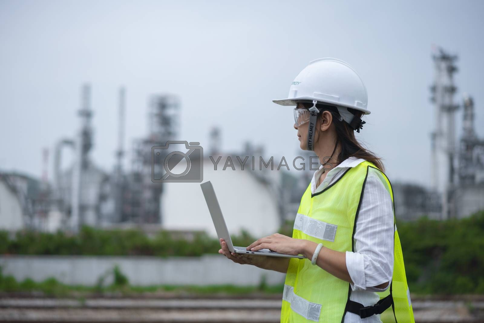 The people worker women engineer work control at power plant energy industry manufacturing oil refinery. petrochemical plant