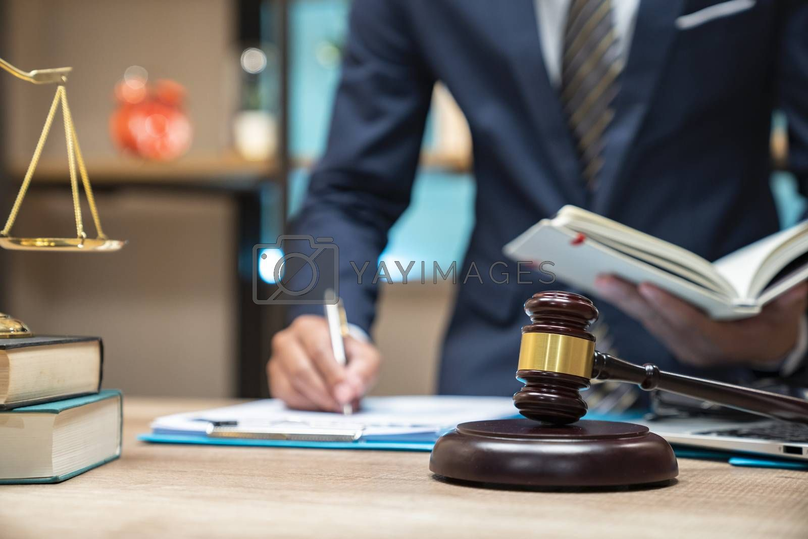 Close up lawyer businessman working or reading lawbook in office workplace for consultant lawyer concept