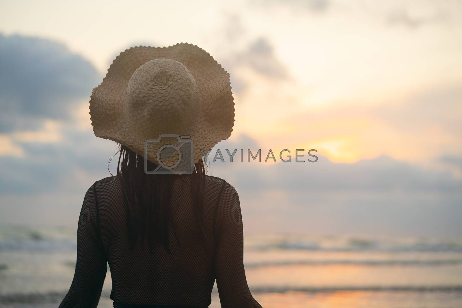 woman stood and watched the missing sun.