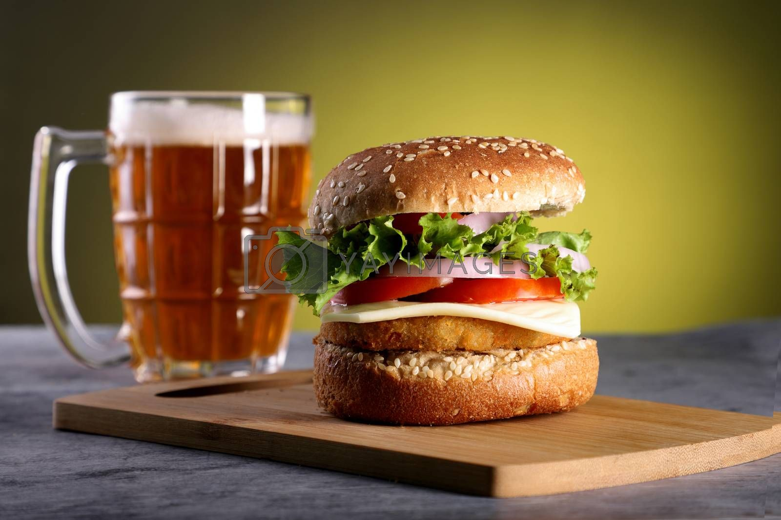Fast Food Burger with a Beer Mug with yellow background
