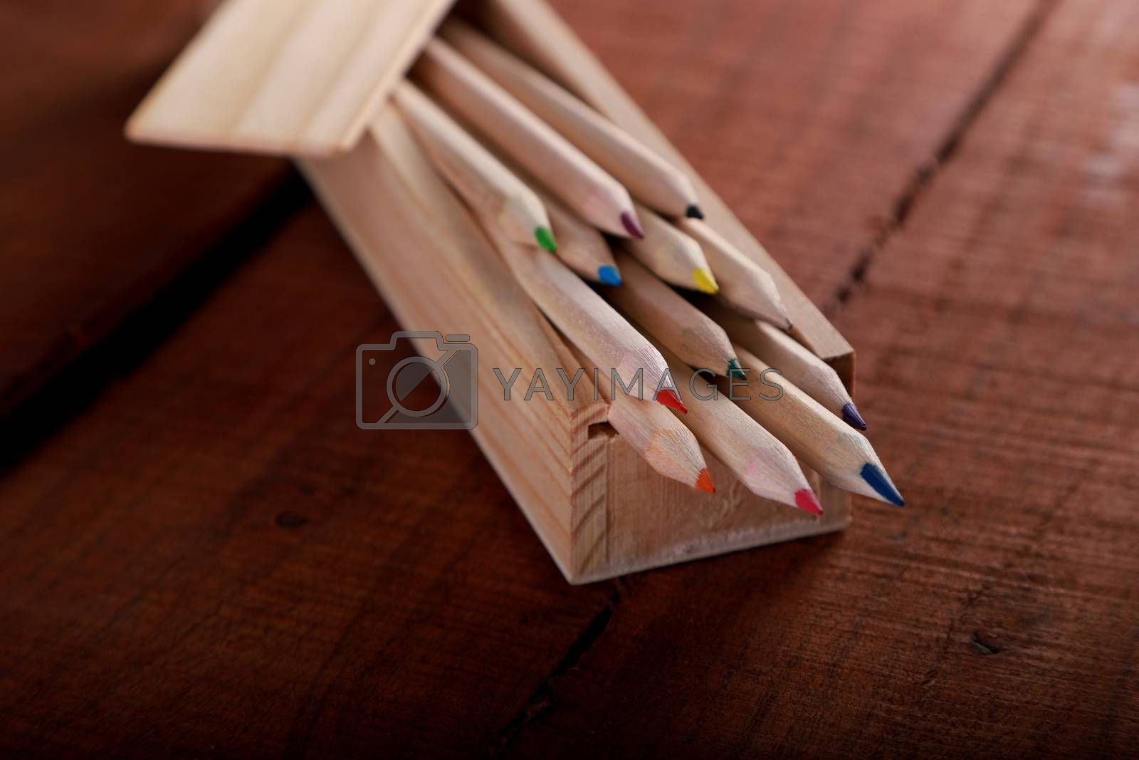 Wooden Colored Pencil on Old Wood Table by Akhilesh