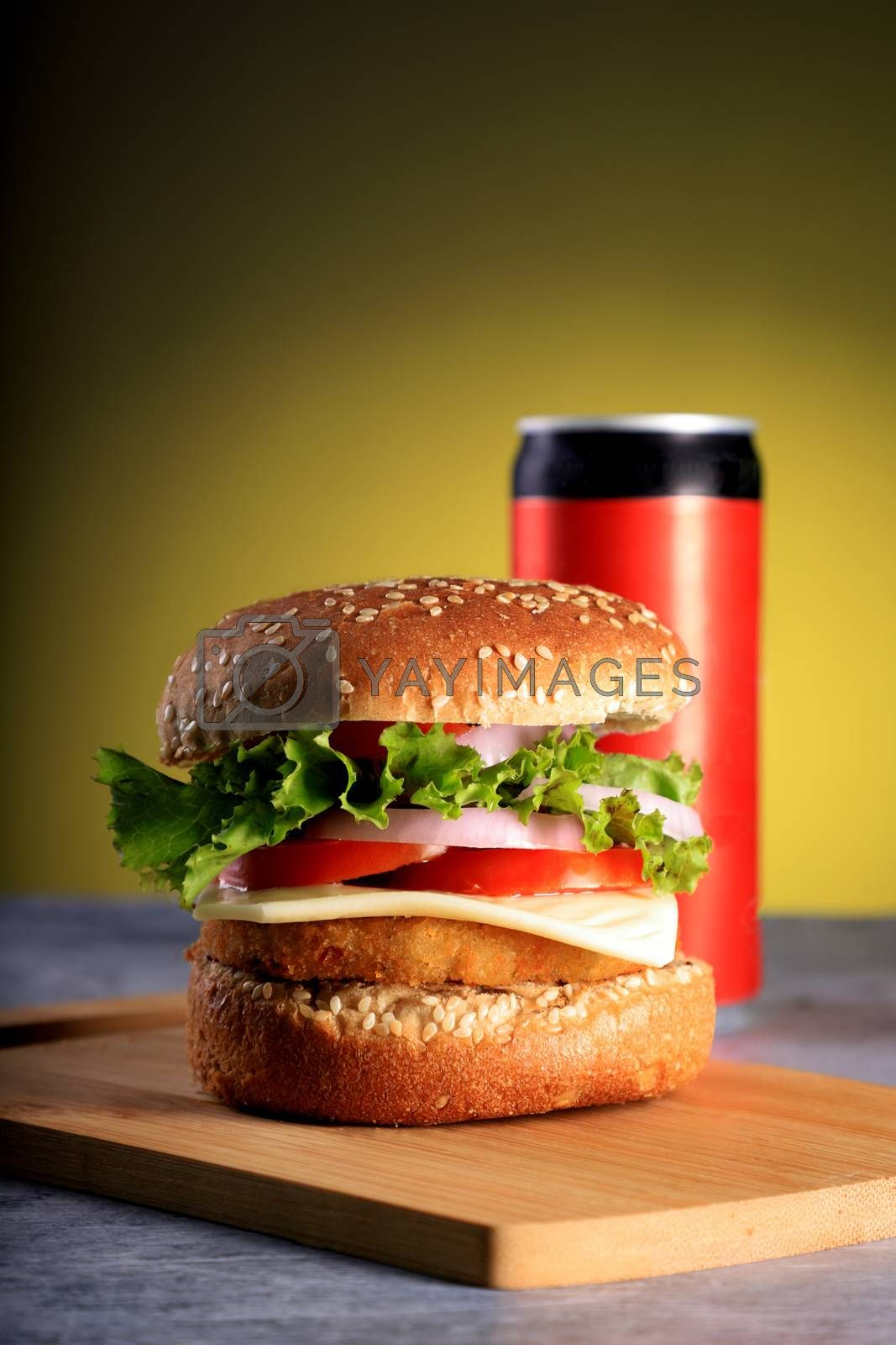 Fast Food Burger with a Cold Drink Can