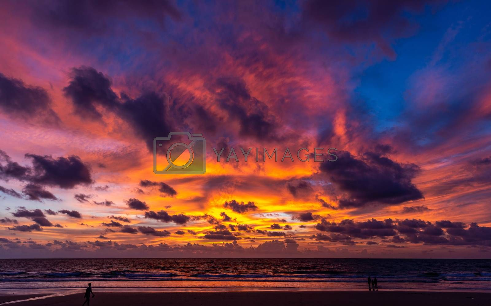 Dramatic twilight cloudy sky in rainy season at sunset over Phuket beach, Thailand.
