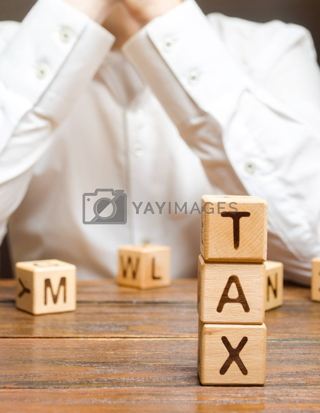 Businessman ponders the process of paying taxes and tax refunds. Tax holidays and benefits. Creating an enabling environment for business and economic growth. Protection of business and industry. by iLixe48
