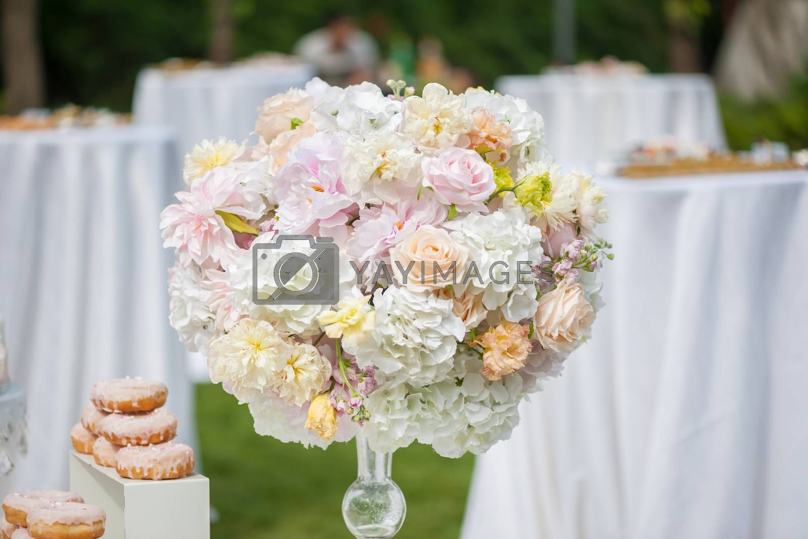 Wedding decoration with flowers and food on a table outdoors
