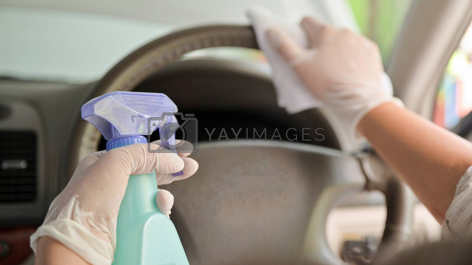 Cropped shot of Spray to clean and disinfect the steering wheel and inside the car.