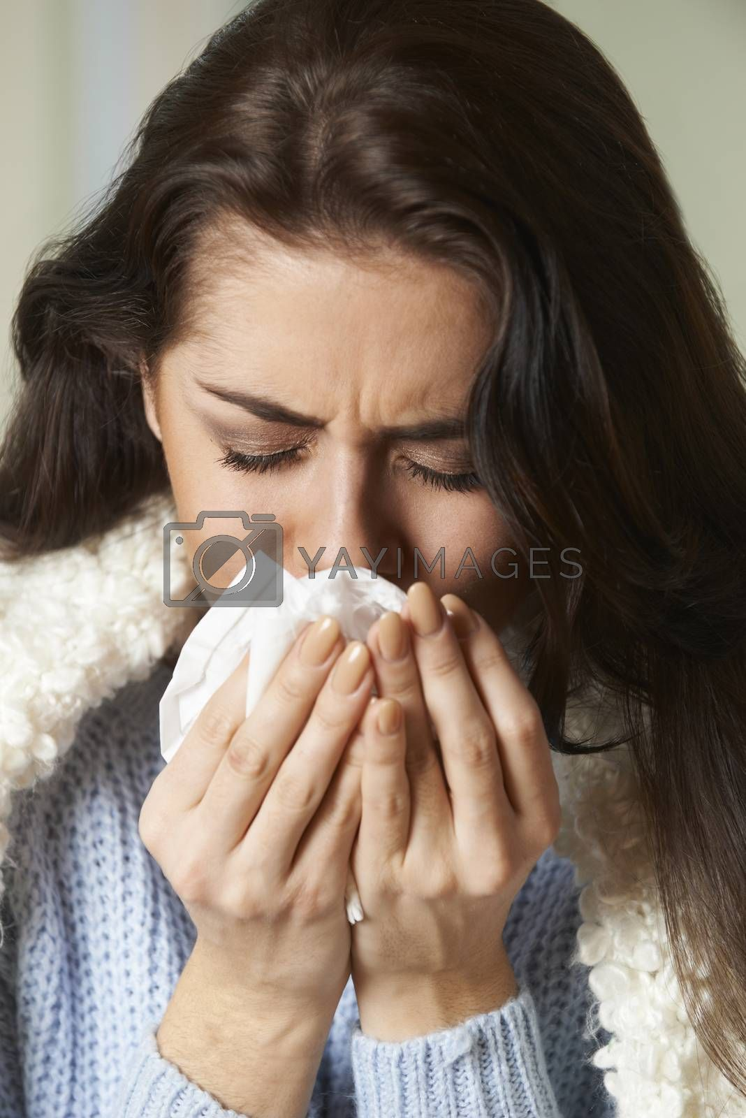 Woman With Cold Holding Tissue And Sneezing