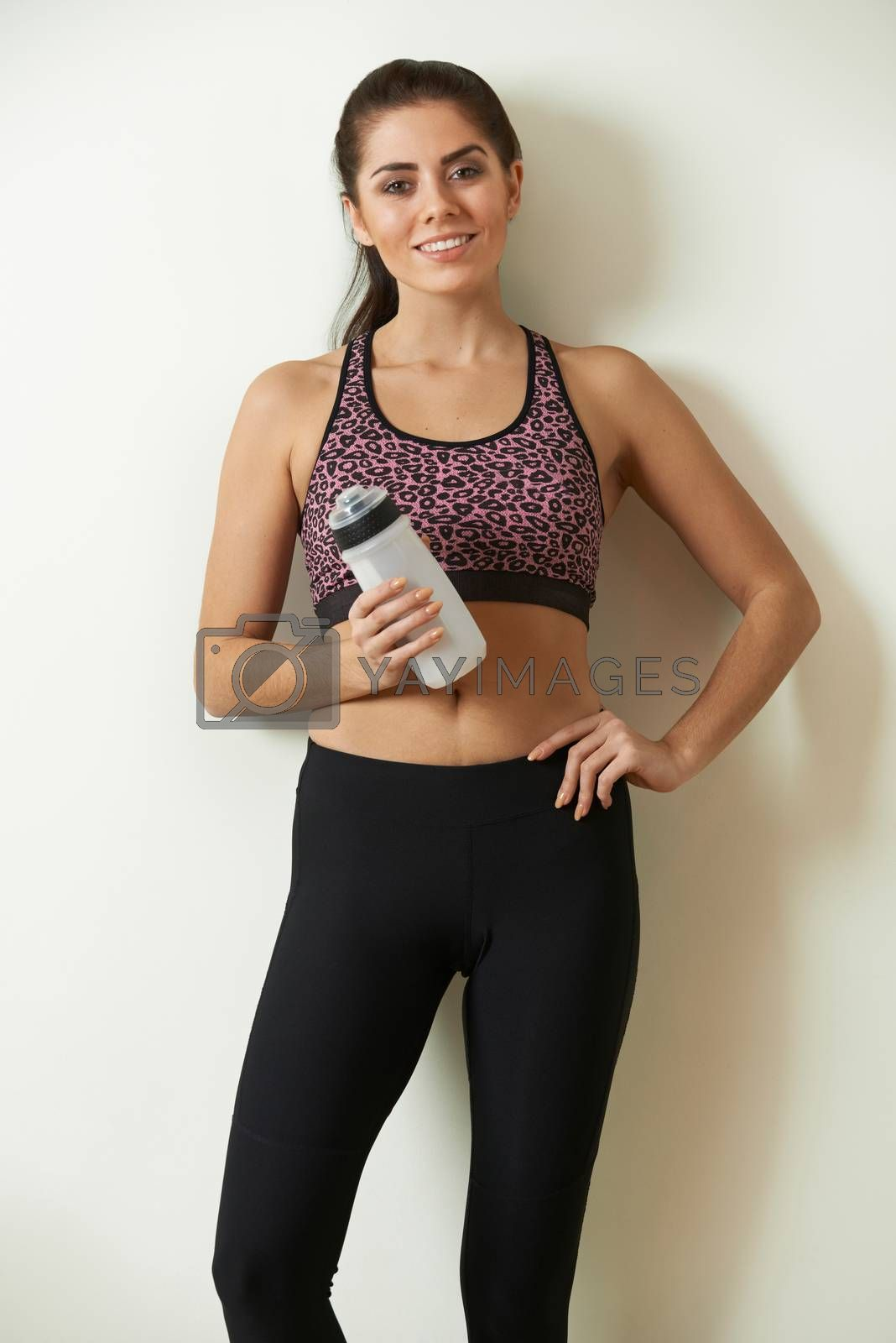 Woman Holding Water Bottle Taking Break During Exercise