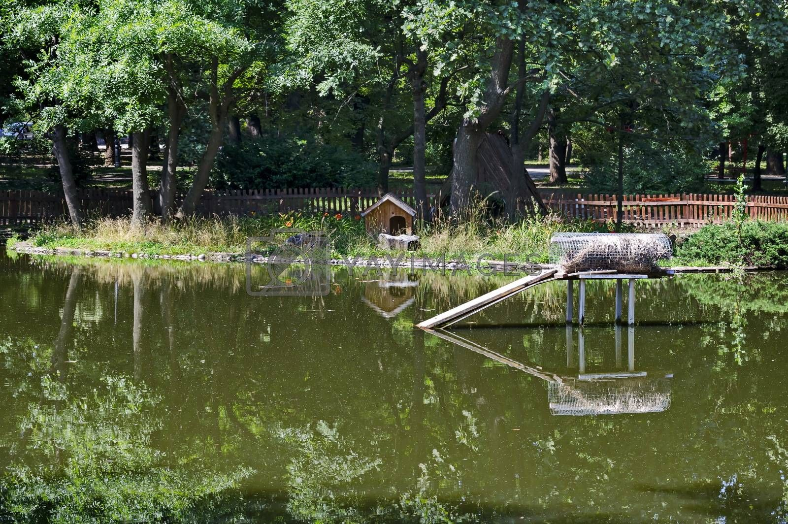 A small house built into the lake and nesting place for ducks in the city garden, Sofia, Bulgaria