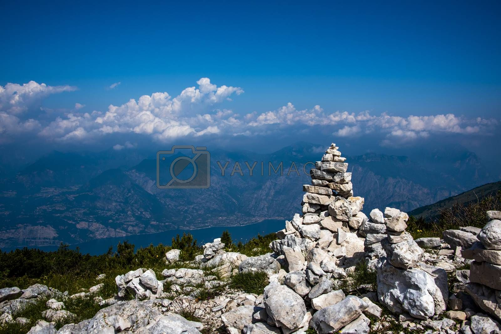 Cairn on the tops of the Venetian pre-Alps on the chain of Mount Baldo on Lake Garda, Malcesine, Verona, Italy