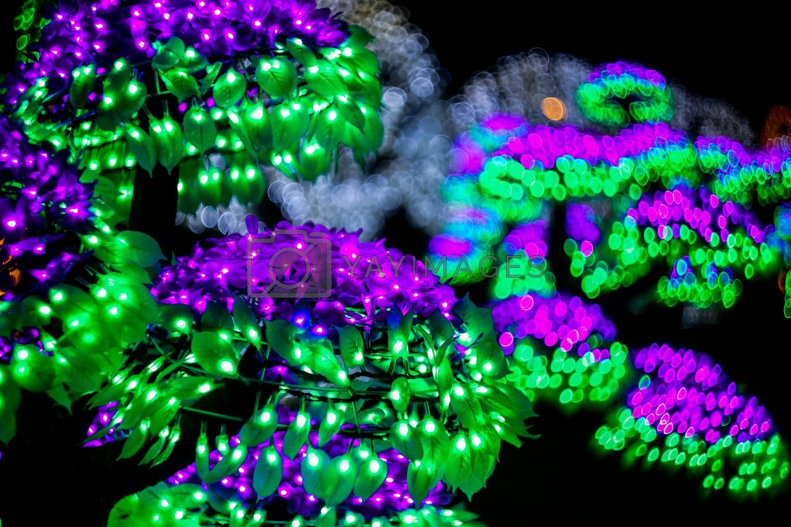 Abstract background with bubble bokeh defocused lights. Majestic tree of lights. Fantastic forest. Copy space.