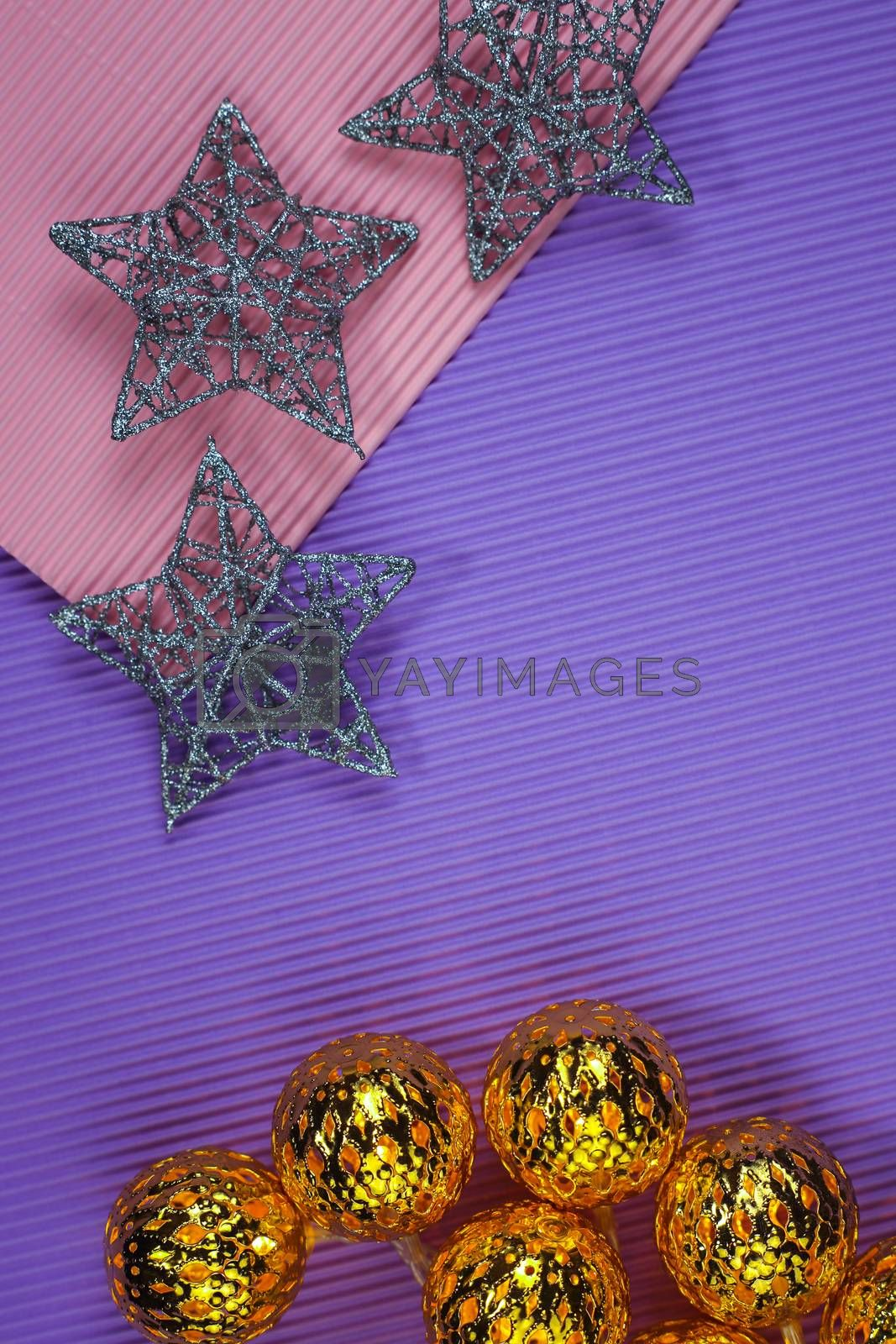 Creative design of Christmas decorations on color paper background. Garland. New Year. Flat lay, top view, copy space.