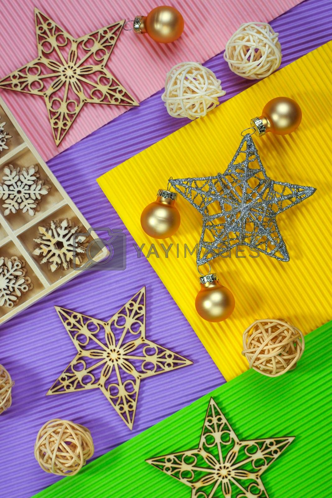 Composition of the Christmas decorations on color paper background. Christmas, winter, New Year concept. Flat lay, top view, copy space.
