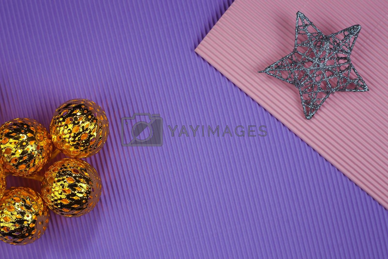 Christmas decorations on color paper background. Composition with garland. Flat lay, top view, copy space.