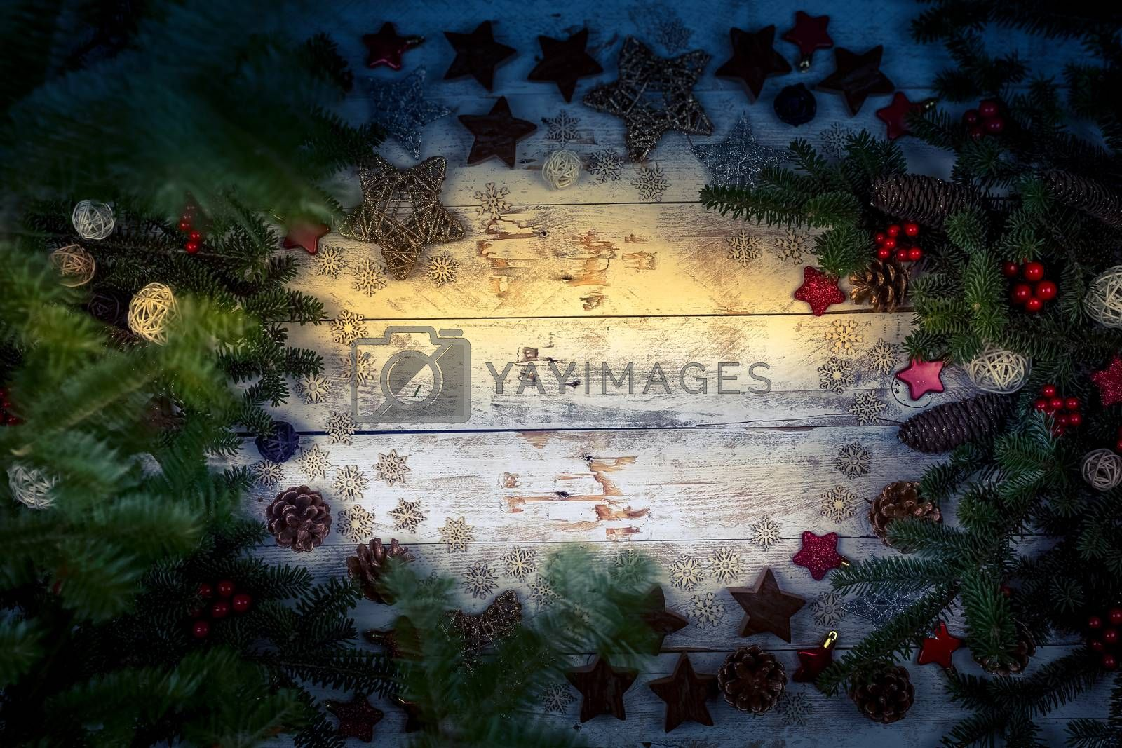 Christmas composition. Frame made of fir branches, cones and decorations. Holiday winter concept of new year on a wooden background. Flat lay, top view, copy space.