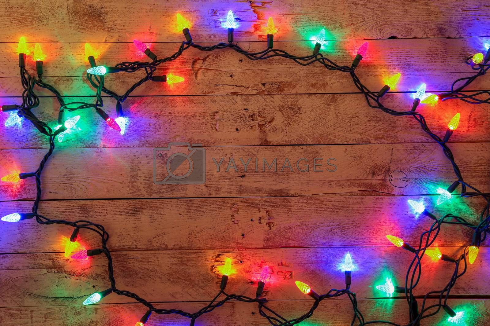 Christmas background with lights and free text space. Christmas lights frame. Garland. Flat lay, top view, copy space. Horizontal shot.