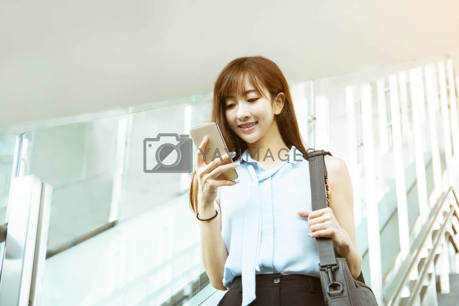 business Woman Going To Work watching the  Phone While Going Downstairs