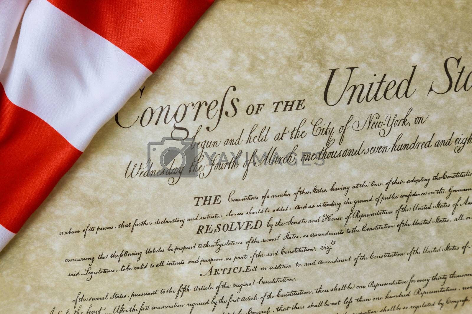 Preamble to the Constitution of the United States of America of close up of ruffled American flag by ungvar
