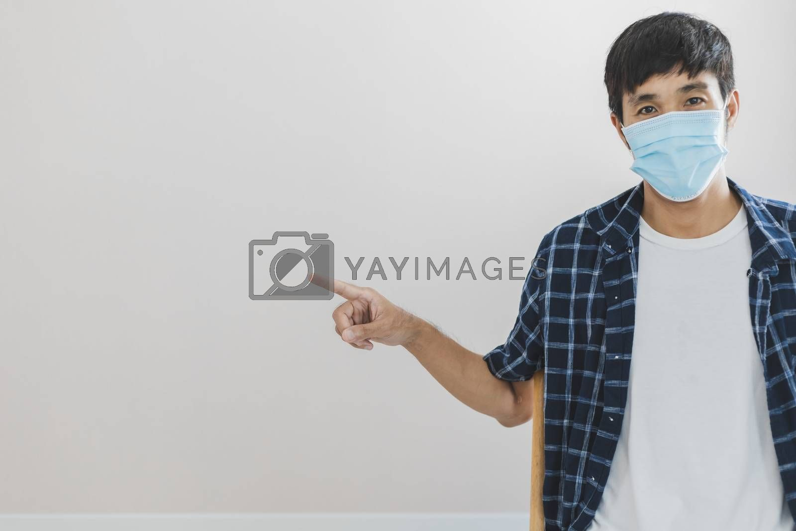Asian man business wear surgical mask creative working online work from home and  shopping online payment price e-commerce shopping online in home lifestyle to new normol