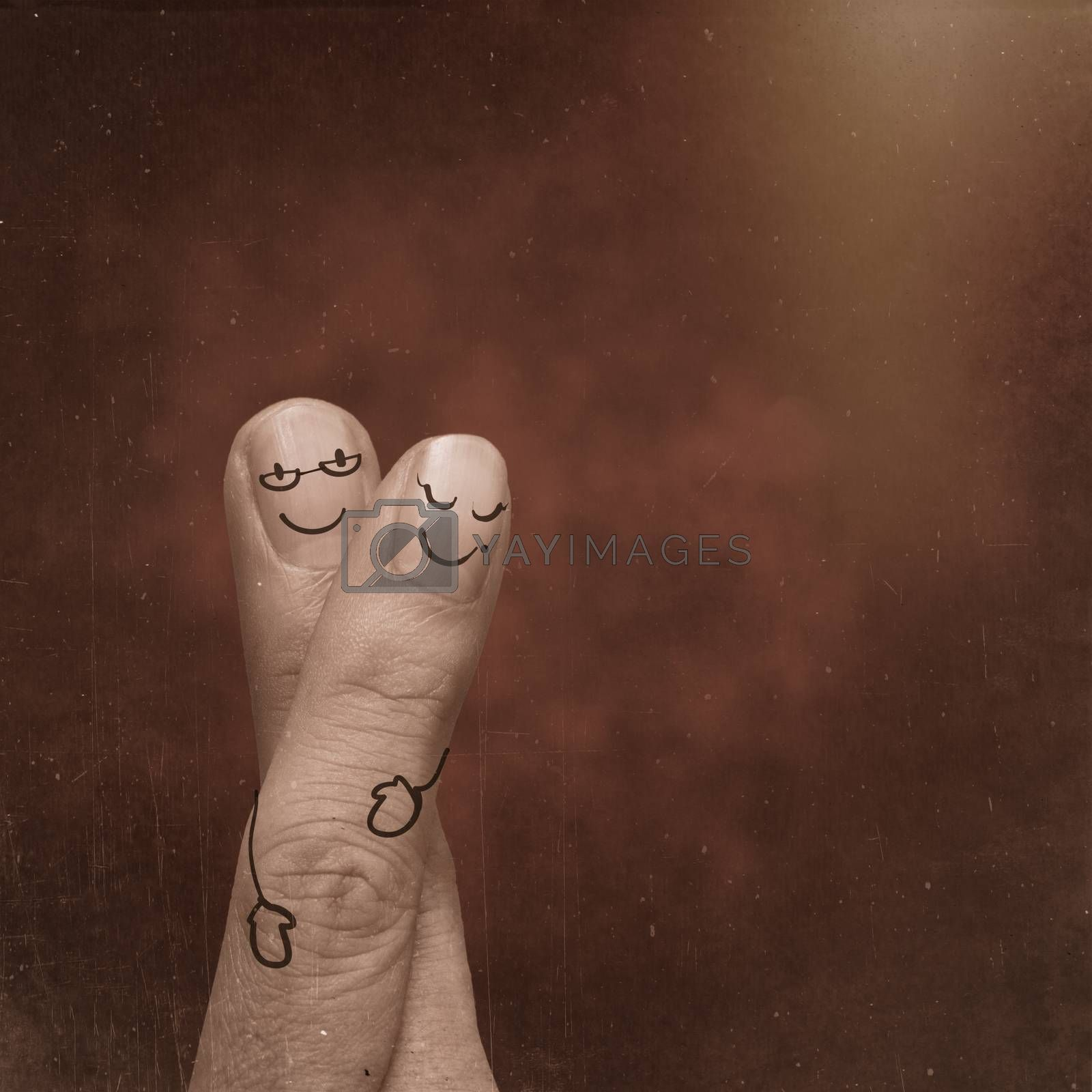 A happy couple in love with painted smiley and hugging as vintage style