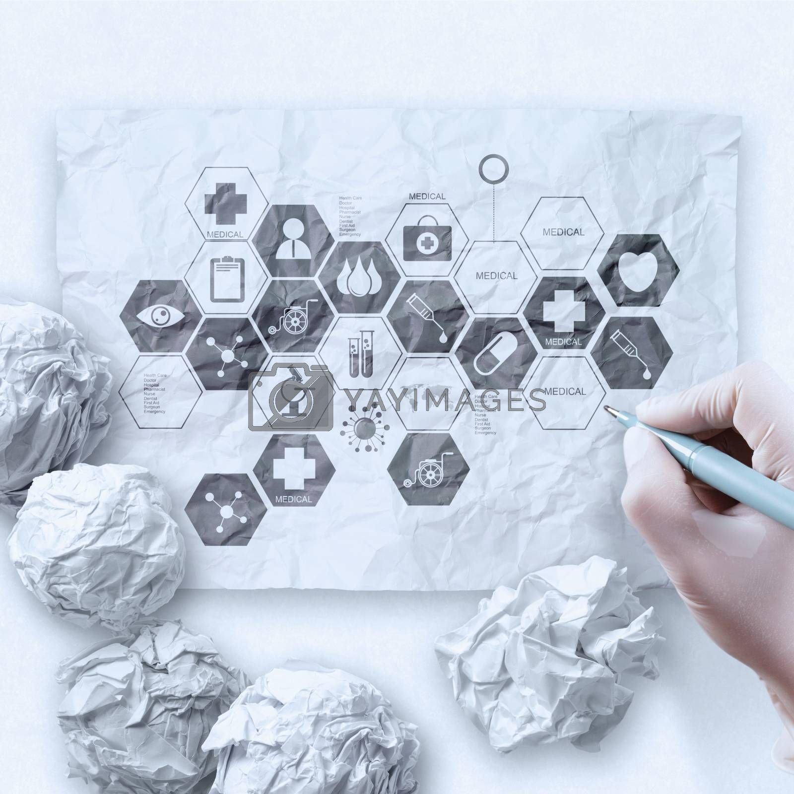 doctor hand draws medical network on crumpled paper as  concept