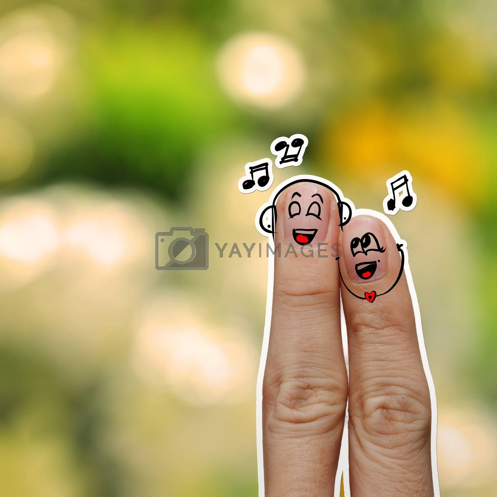 the happy finger couple in love with painted smiley and sing a song on flower nature background